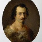 Portrait of a young man with facial hair wearing fur.