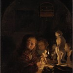 2 children sit at a table, illuminated by a candle. On the table are a series of white statuettes.